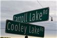 Carroll Lake Road and Cooley Lake Road Signs