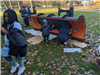 Side Angle View of Students Painting the Plow