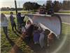 Straight View of Students Painting the Plow