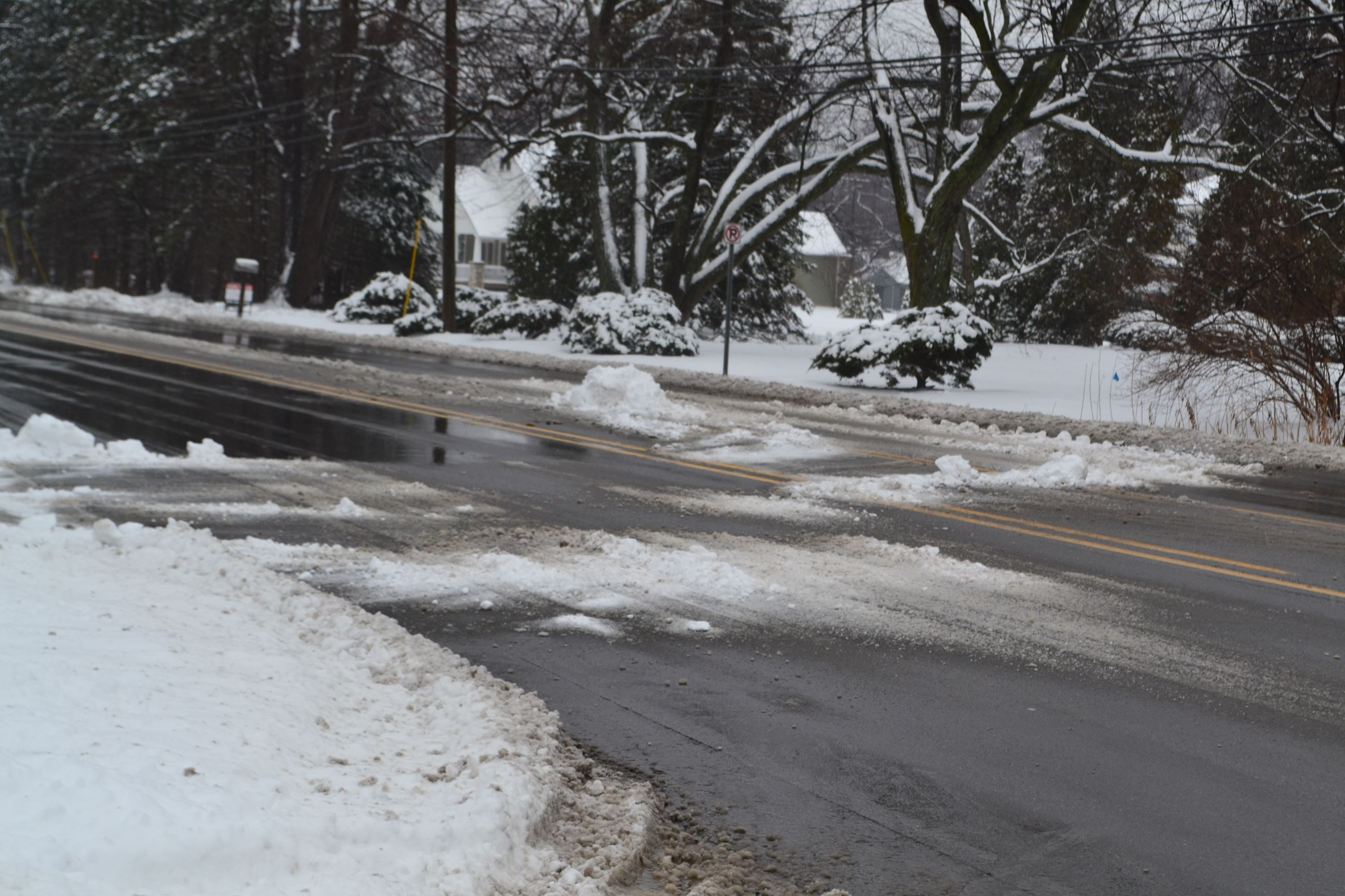 Illegal snow plowed back in Lahser Road