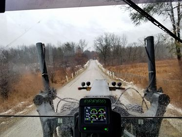 Grader on gravel road (credit to RCOC employee Eric J.)