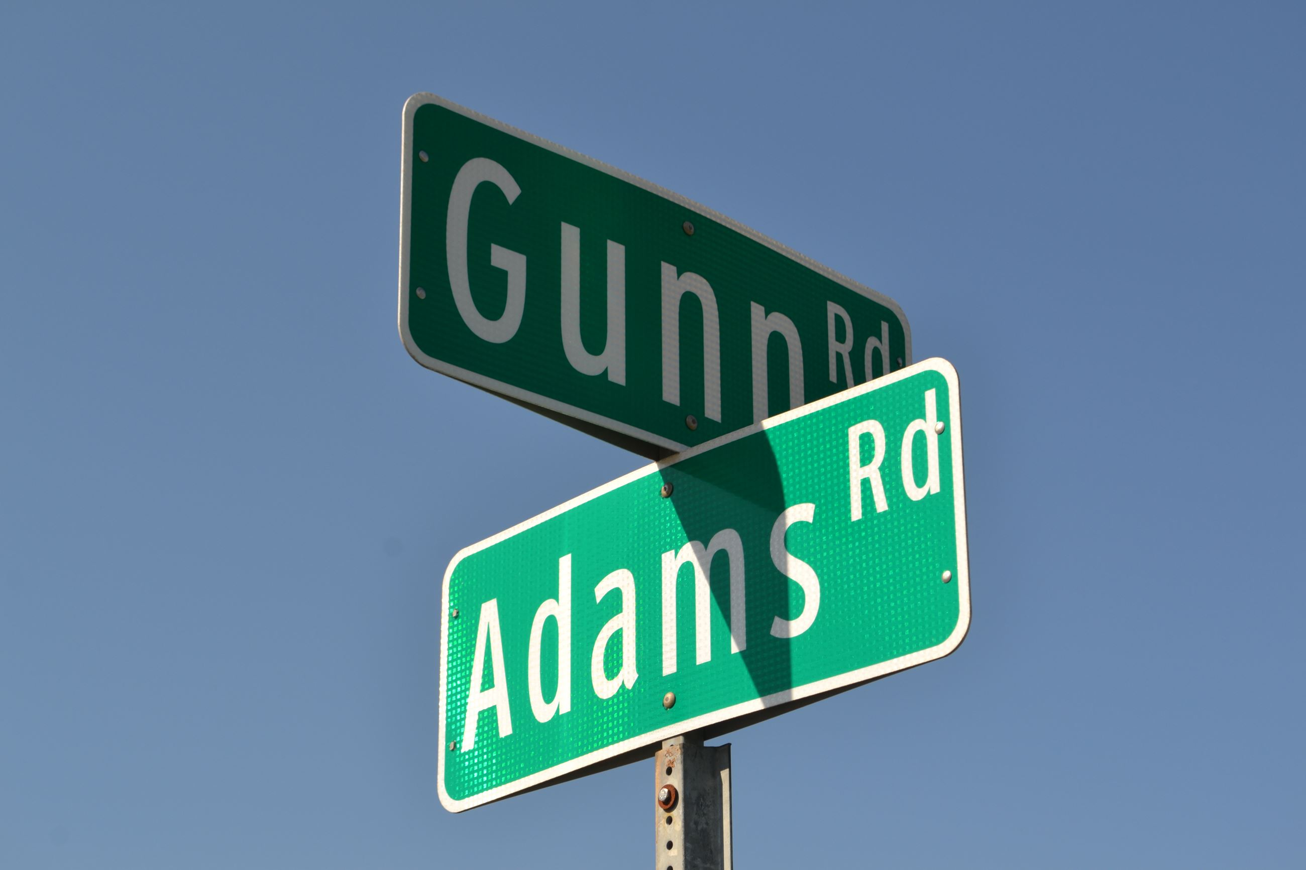 Adams and Gunn Road Sign