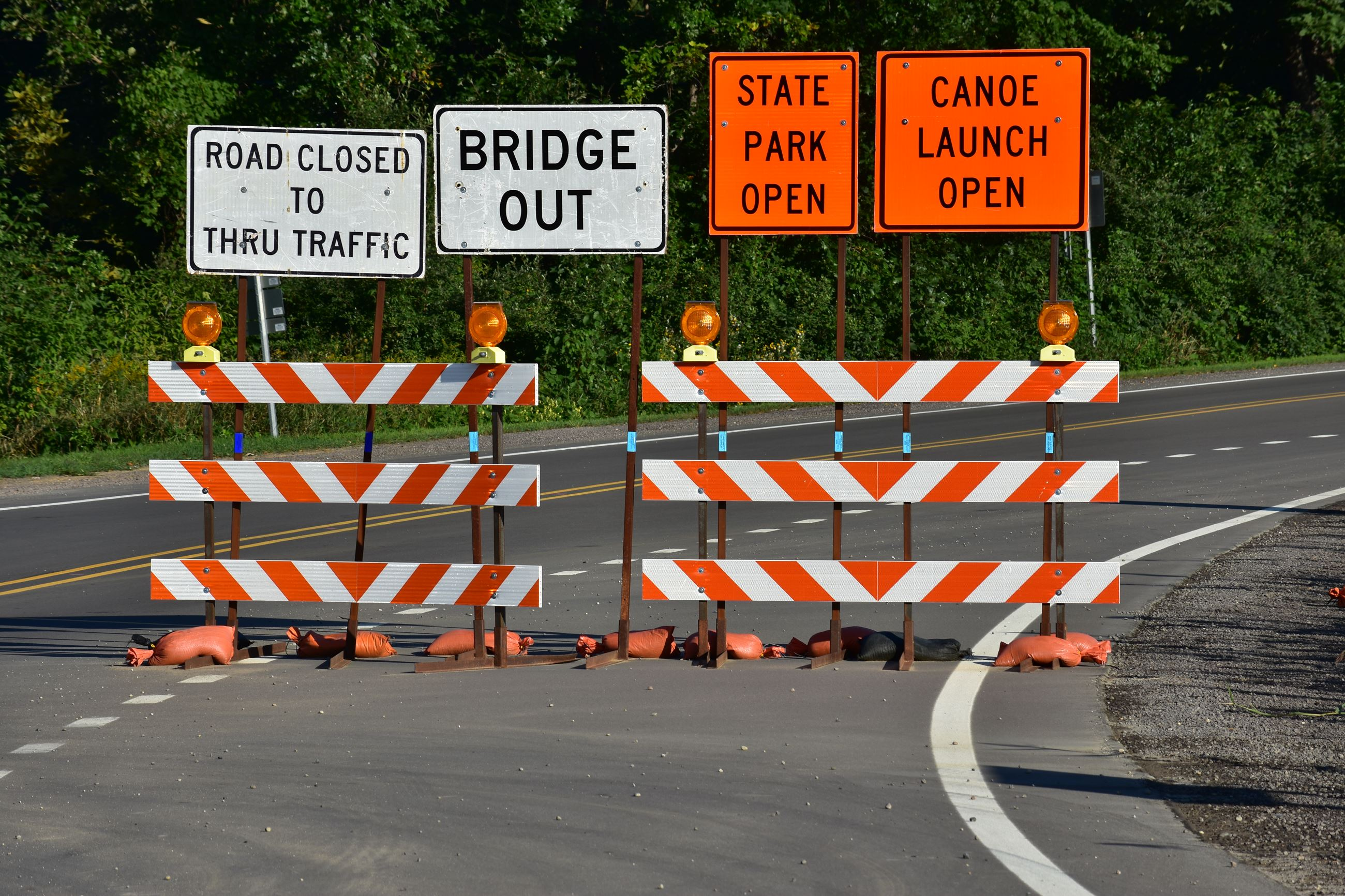 Wixom Road closed, bridge out, state park open and canoe launch open signage