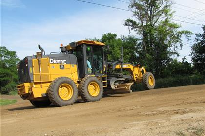 Grading a section of a gravel road in Oakland County.